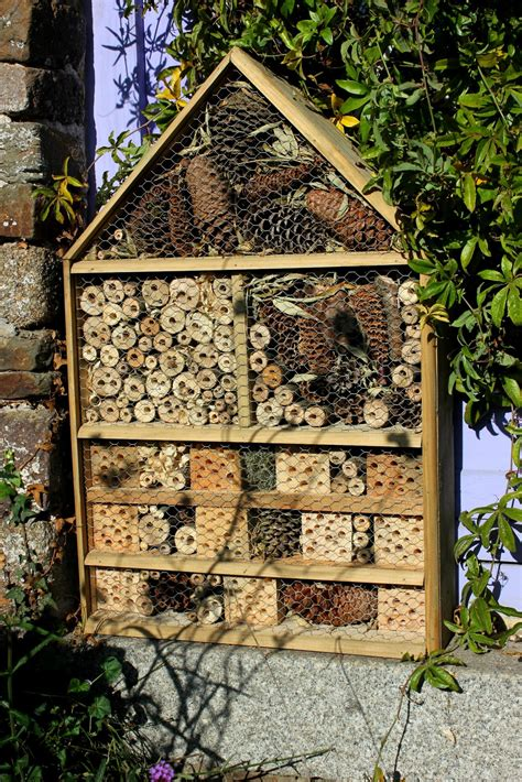 house and garden pest home made repurposed wood luxury insect hotel or five