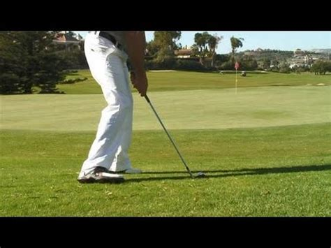 videojug golf swing how to chip from a downhill lie here s a swing by