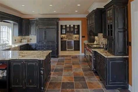 Does Flooring Go Cabinets by These Cabinets With The Colored Slate Floor Are