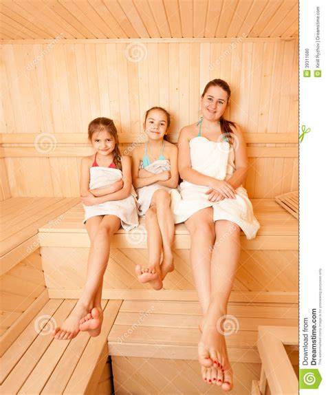 daughter in bathtub mother with two daughter relaxing at steam bath stock
