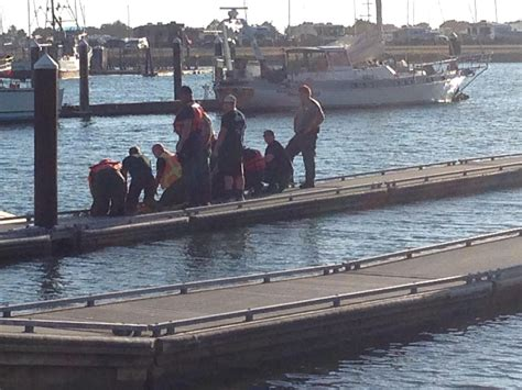 boating accident oregon coast guard diver pulled boy 6 from beneath capsized