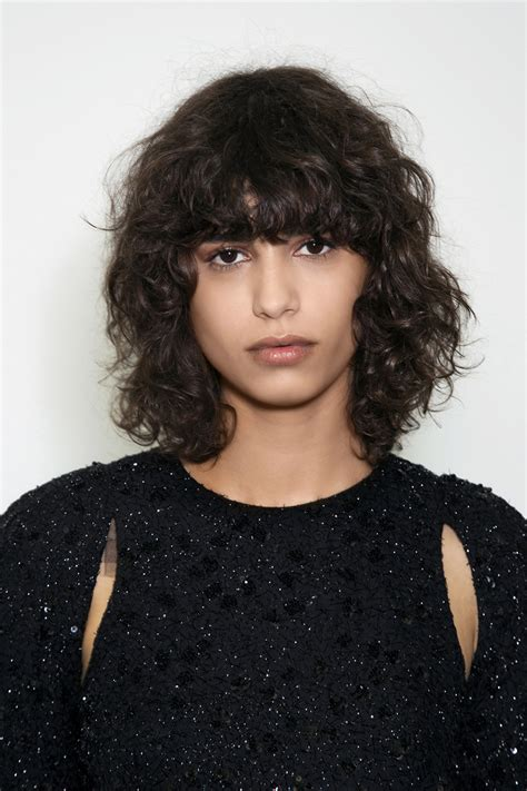 hairstyles with bangs and curly hair yes curly bangs are back here s how to pull them off