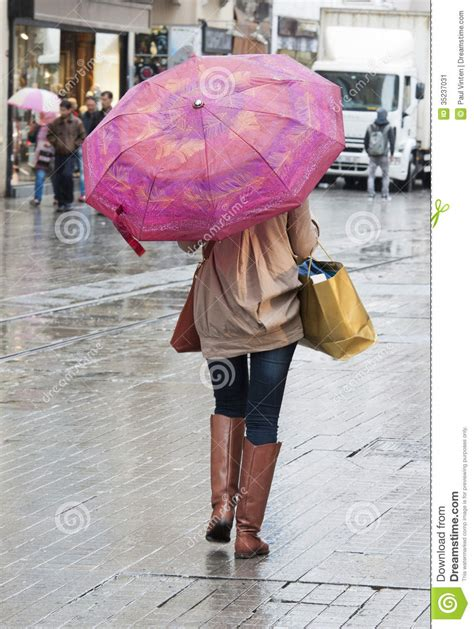 X2 3746 St Umbrella with umbrella walking stock image image 35237031