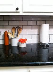 White subway tile with dark grout little green notebook