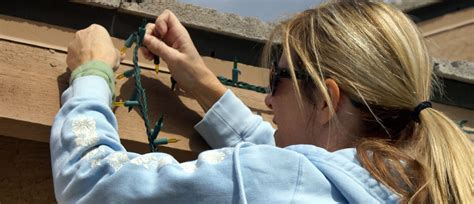 hanging christmas lights with gutter guards how to hang christmas lights with gutter guards