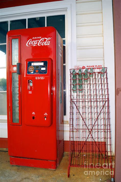 the coca cola machine and bottle rack outside billy