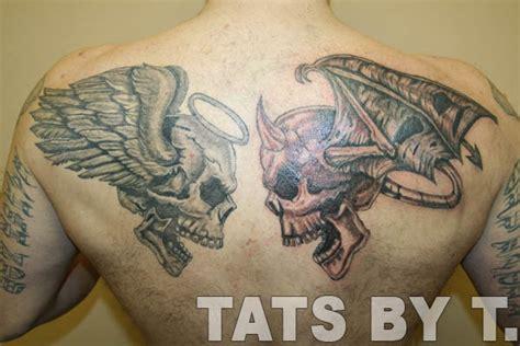 and skulls tattoos on back