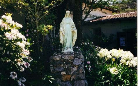 The Garden Of Santa by Statue In The Garden Of Mission Santa In