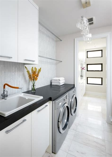 White Cabinets Laundry Room Bright Laundry Room Marble Flooring Black Countertops Pendants Lighting White Cabinets