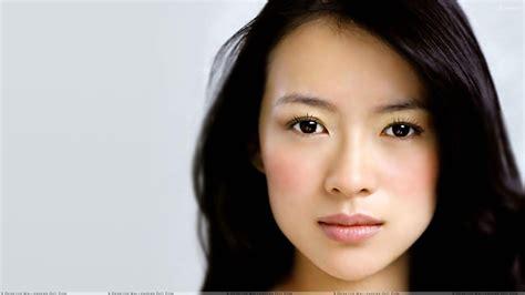 asian english actress zhang ziyi looking at camera sad face closeup wallpaper