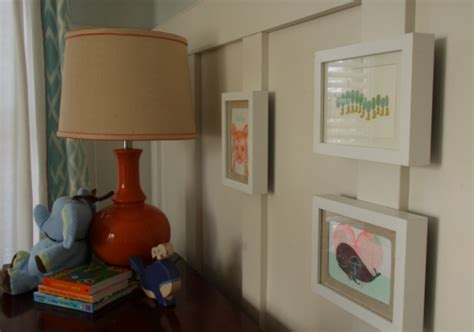 Above the dresser hangs a simple framed letterpress greeting cards