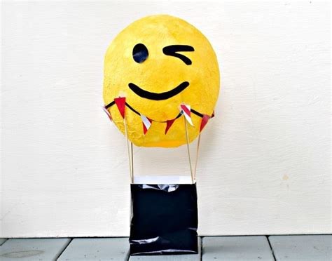 make your own air balloon centerpiece emoji themed or