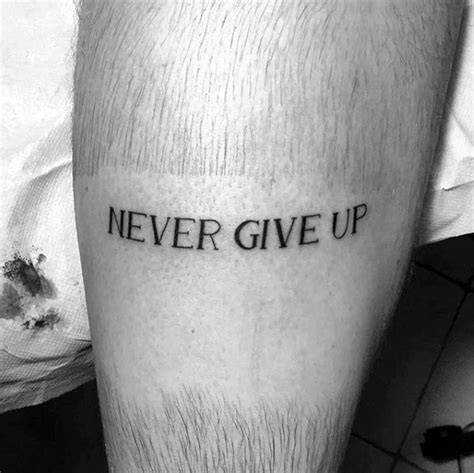 tattoo lettering never give up 60 strength tattoos for men masculine word design ideas