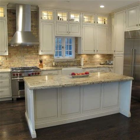 kitchen appliances chicago kitchen brick backsplash high end appliances and a large functional island love the lights at