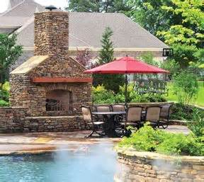 hidden backyard pool backyard with a giant pool hidden cave firepits slide pool house more patio