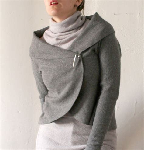 Ready Roundhand Sweater 1 womens wrap sweater in boiled wool with kilt pin closure
