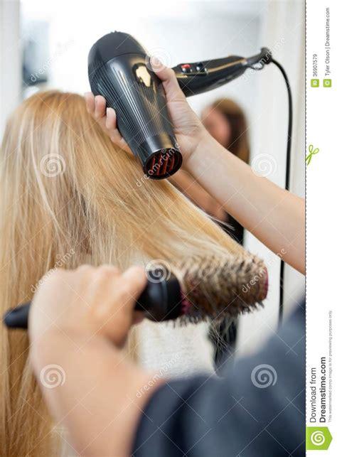 Hair Dresser On by Stylist Drying S Hair In Hairdresser Salon Stock