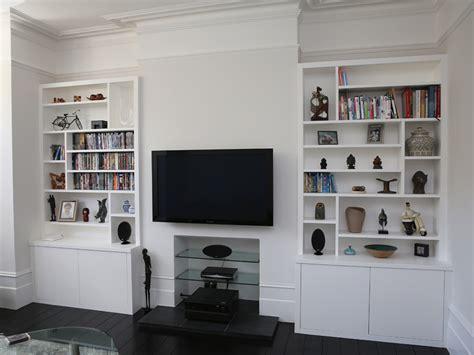 Sleek white built in alcove cupboards   Bespoke Furniture