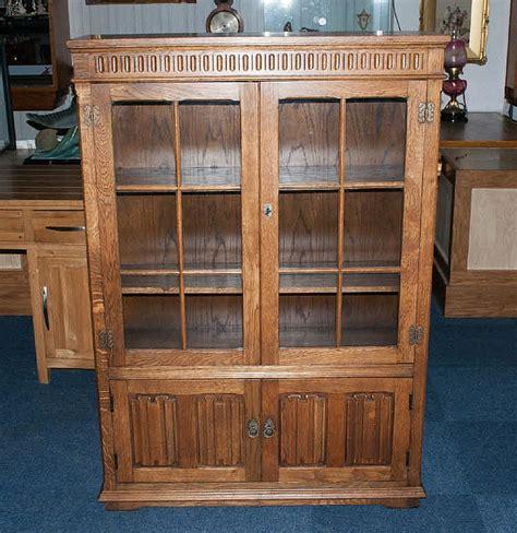 golden oak cabinet doors a golden oak double door glazed display cabinet with the moc