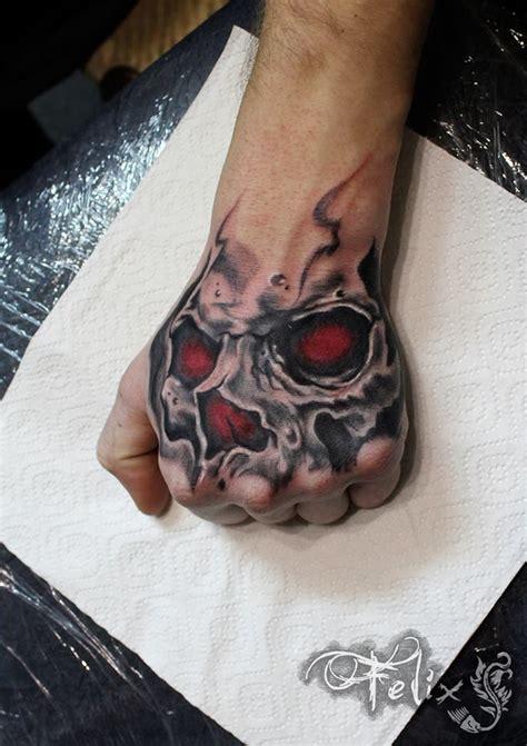 skull hand tattoo skull tattoos for ideas gallery designs
