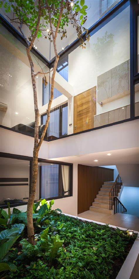 narrow dwelling in toronto converted into bright family wrecked building in thailand converted into surprising
