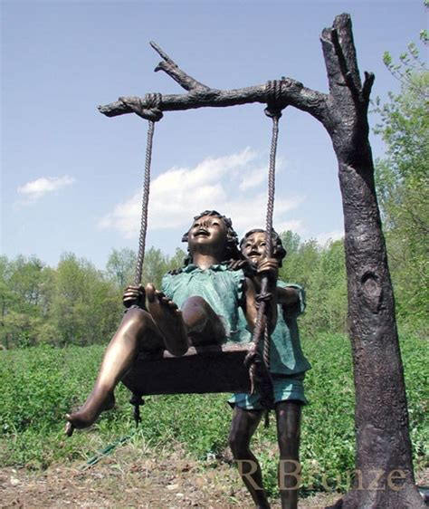 new to swinging kids swinging bronze sculpture