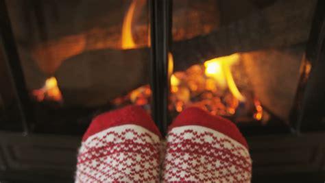 sock fireplace in warm socks in front of fireplace in winter
