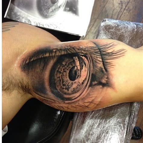 amazing grey ink eye tattoo on bicep tattooshunt com