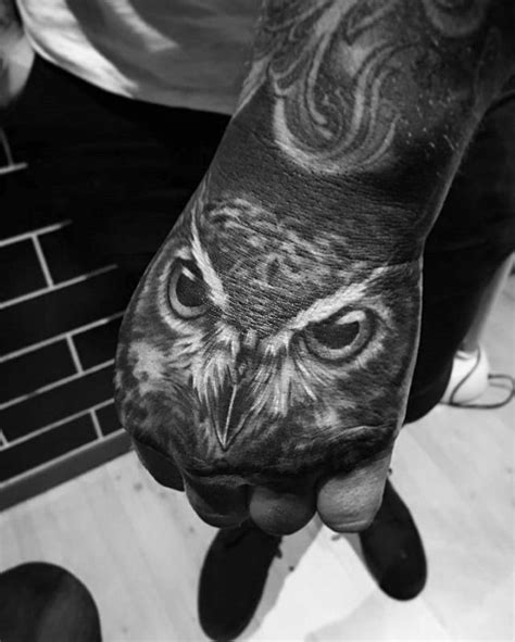 owl tattoo designs on hand heavily shaded mens realistic owl hand tattoo el primero