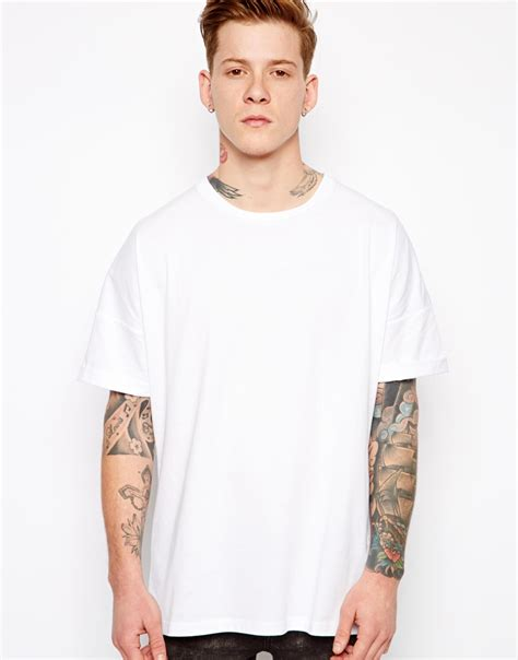 design free asos t shirt asos t shirt with oversized fit and roll sleeve in white