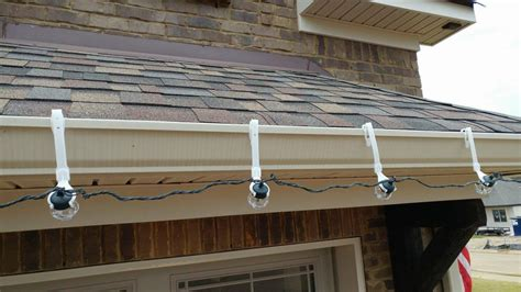install christmas decorations on roof things to before hanging decorations suncoast roofing solutions