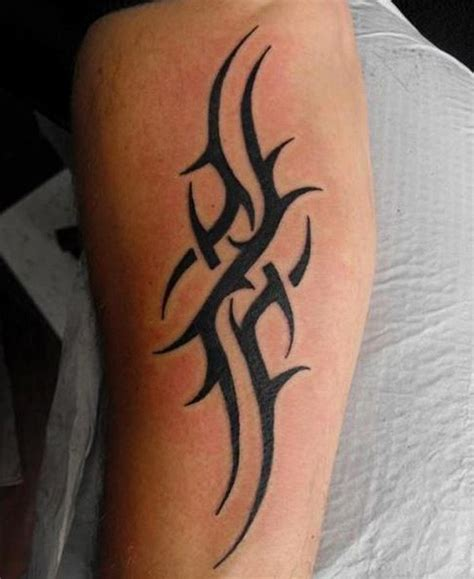 simple arm tattoos for men 52 most eye catching tribal tattoos