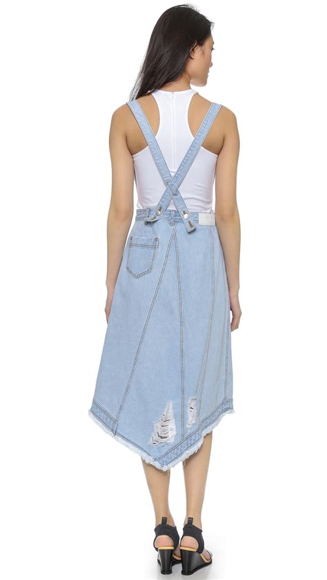 Suspender Denim Skirt sjyp destroyed denim wrap skirt with suspenders in blue lyst