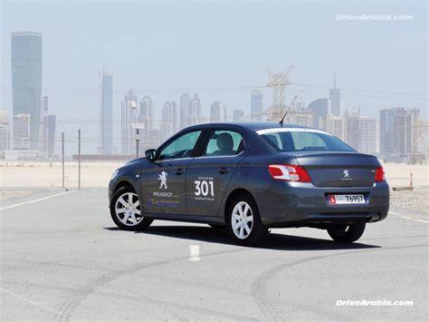 peugeot uae first drive 2013 peugeot 301 in the uae drive arabia
