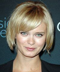 ear length haircuts for thick hair perfect ear to chin length bob with thick bangs on one