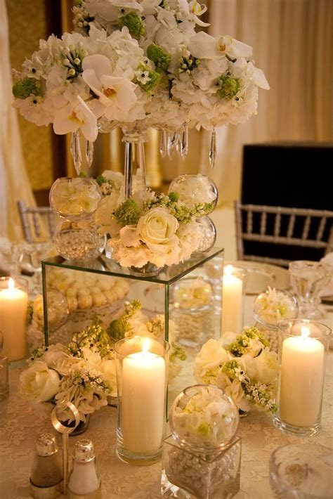 Mini candleabra on mirror vase with selection of candles