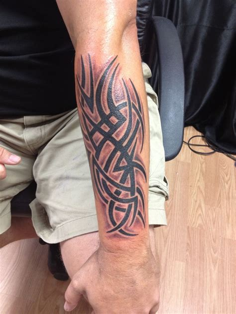 left arm tattoos left forearm tribal white ink