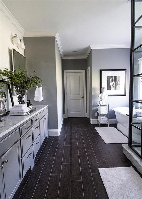 bathrooms with dark wood floors dark wood like tiled bathroom floor transitional bathroom