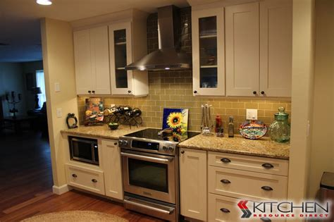 small white kitchen with steel hood stainless steel oven hood and oven transitional kitchen