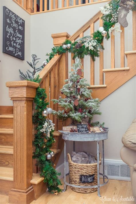 Garland Hangers For Banister by How To Hang A Garland On The Stairs Clean And Scentsible