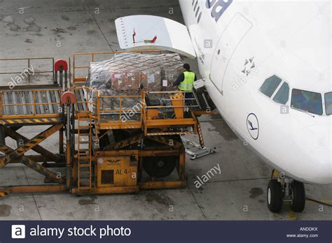 loading air cargo on board a lufthansa airbus a340 300 airliner stock photo royalty free image