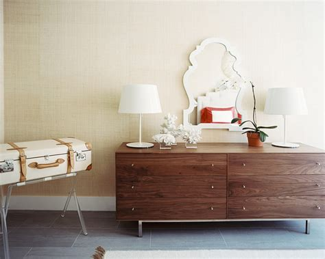 bedroom a wood dresser accented with white accessories