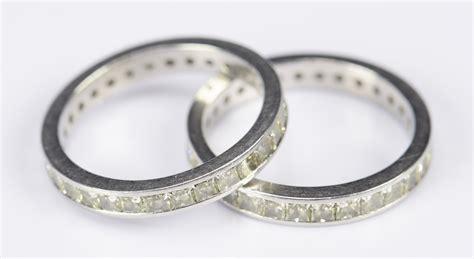 lot 415 pair yellow platinum eternity rings