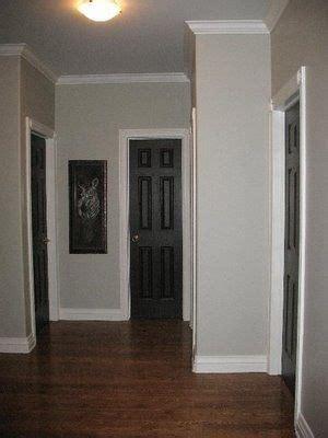 light grey walls white trim  black doors nice combo