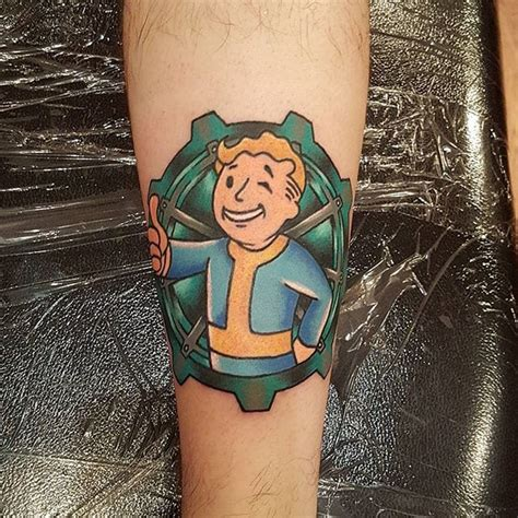 video game tattoo designs 15 cool vault boy tattoos for all fallout fans tattoodo