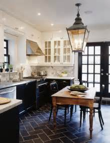 white cabinets and black lower cabinets