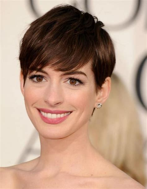 pixie cut hairstyle for age mid30 s anne hathaway 7 of the best bangs in hollywood hair