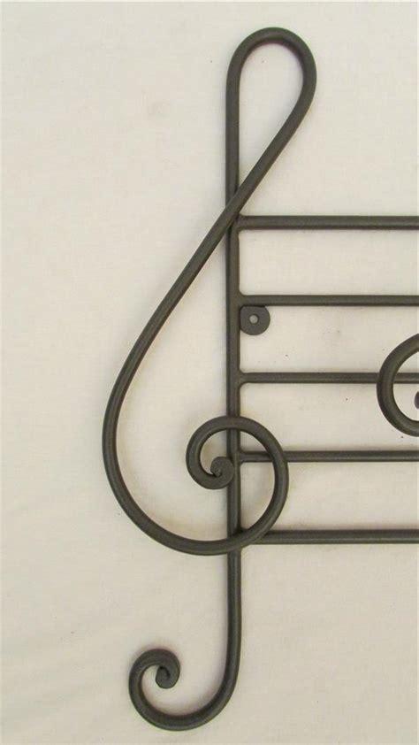 tavoli stravaganti attaccapanni a 4 note musicali in ferro battuto lavorato a