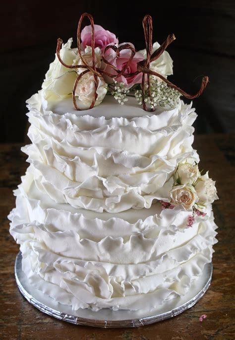 a shabby chic wedding cake and some wedding decor pics