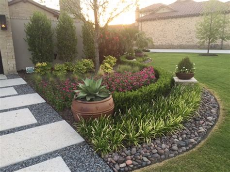 river rock flower bed how to lay river rock landscaping everything about